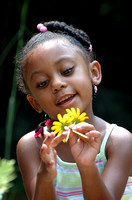 100167 Child Gazing At Flower