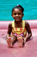 100263 Little Girl Sitting On Raff In Pool