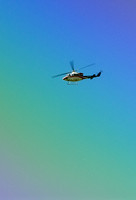100303 Helicopter Flying Against A Rainbow