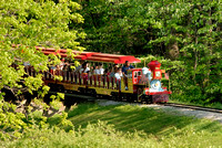 102602 - People Riding Train Through Amusement Park