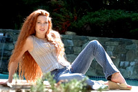 101285 Woman Sitting Outdoors With Long Red Hair