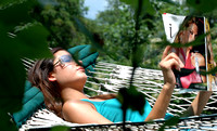 100101 Teenage Girl Lying in Hammock Reading