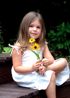 100178 Little Girl Sitting On Step With Flowers
