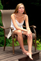 101568 Woman Sitting In Chair Outside Wearing Summer Clothes