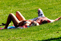 102607 - Young Couple Sunbathing in a Park