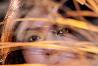 105420 - Woman's Face Through Golden Grass