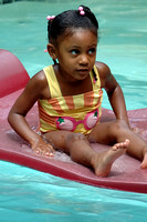 100262 Little Girl Floating In Swimming Pool