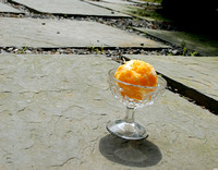 100183 An Orange In Crystal Glass